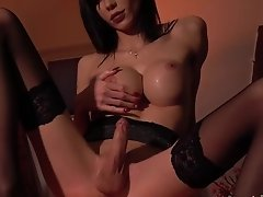 Bailee Paris jerks off her massive tgirl love stick while sitting on a copper table