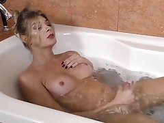 Angelina enjoying a nice soapy bath and a passionate jerking of her massive dick