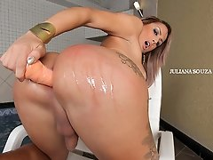 Juliana Souza likes to stuff her tight shemale ass-hole with a huge toy!