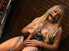 Shackled and chained TS Jesse masturbating