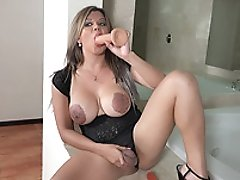 Busty TS Naomi Chi putting TWO DILDOS everywhere